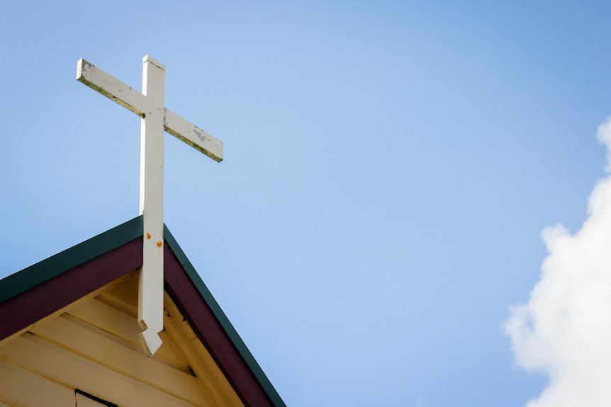 A cross on top of a church.