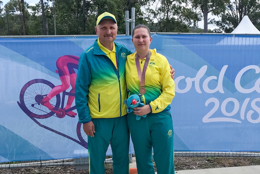 Elena Galiabovitch with her bronze medal around her neck, poses for a photo with her father Vlad.