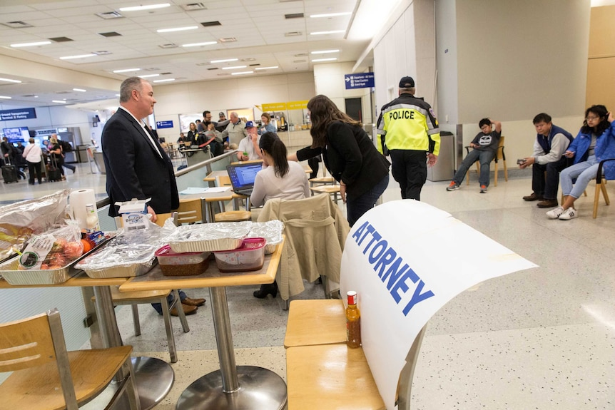 Lawyers set up in the arrivals area of Dallas Fort Worth International airport