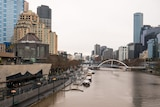 A photograph of a deserted Melbourne CBD with the Yarra River in view