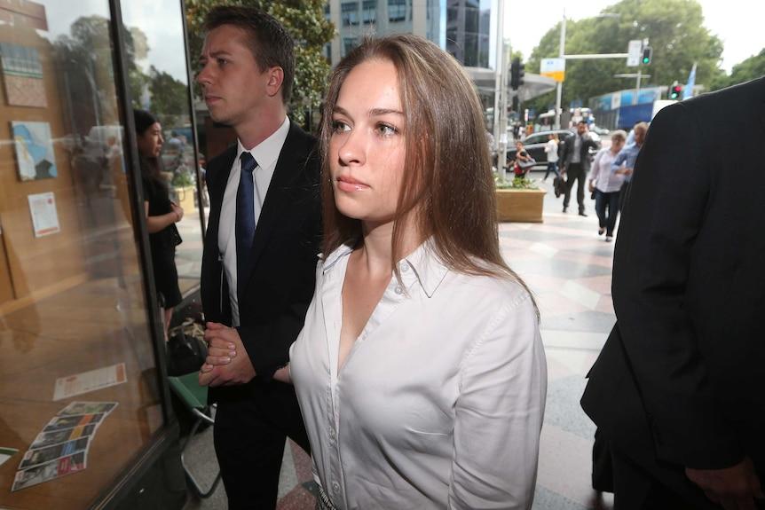 Stefanie Jones arrives with her fiancé David Latham (left) to Downing Centre Court