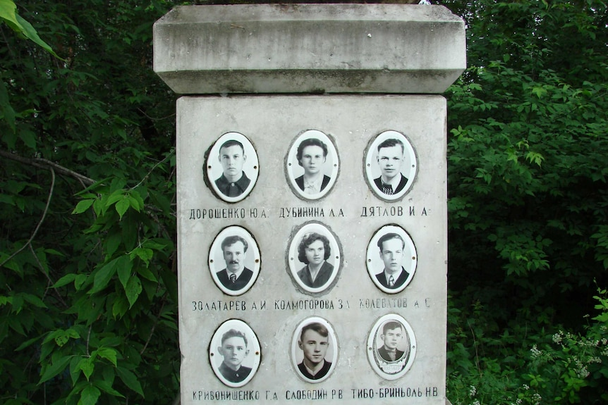 A headstone with nine black and white photos of young people and their names.