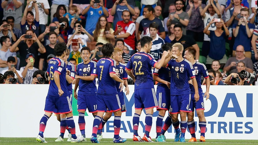 Japanese players celebrate a Keisuke Honda goal during the 2015 Asian Cup