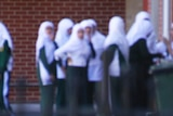 Islamic College students in grounds.