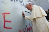 Pope Francis praying at Israel's separation barrier