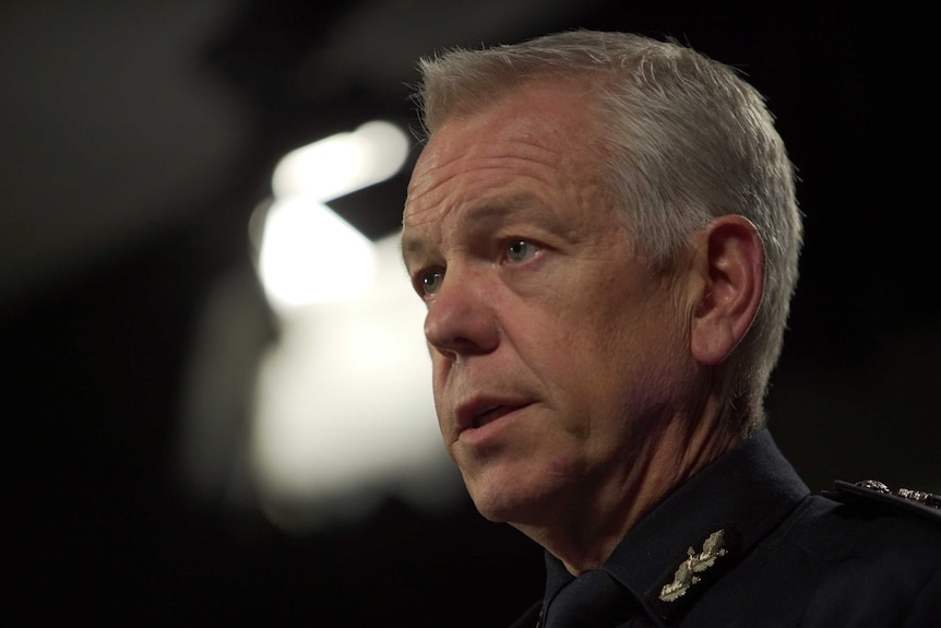 A close-up image of Police Commissioner Grant Stevens in his police uniform at a press conference in July 2020.