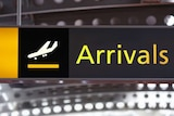 Arrival sign in airport, generic image.