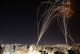 Streaks of light visible as Israel's Iron Dome defence system intercepts Gazan rockets.