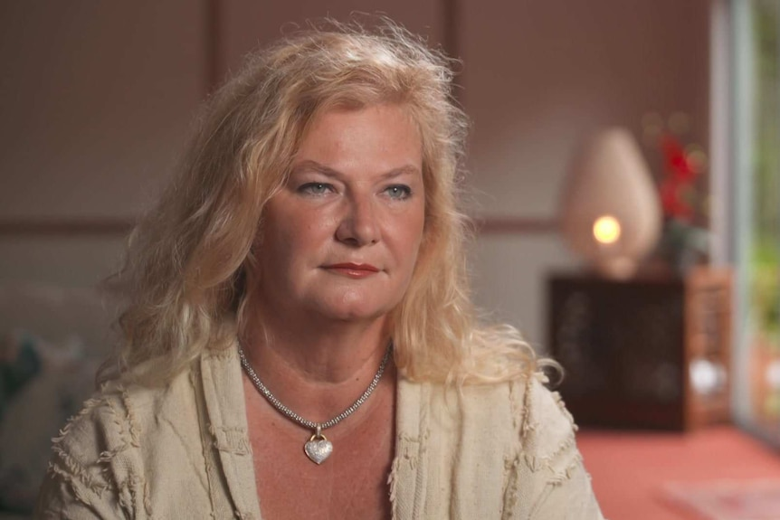 Woman looking at an interviewer.