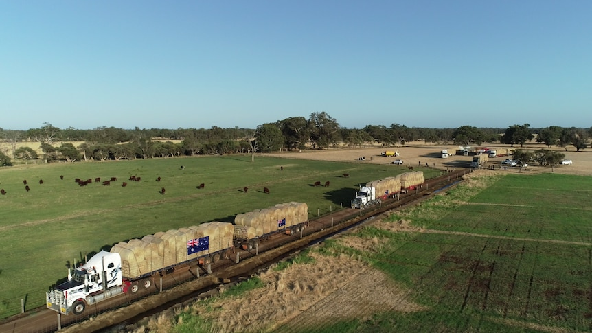 A drone shot of trucks driving down the road