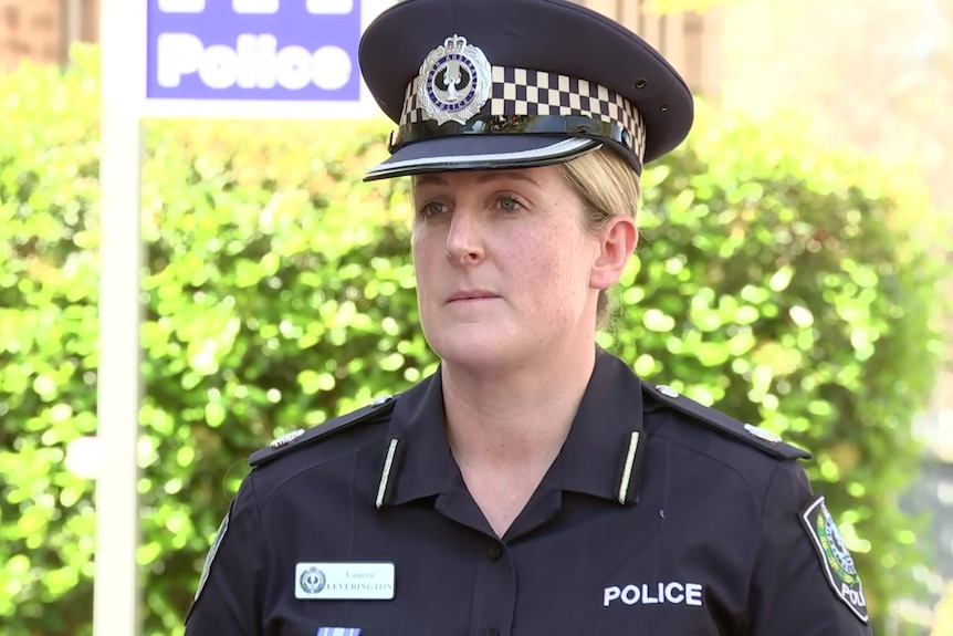A profile shot of a female police officer wearing her uniform and cap