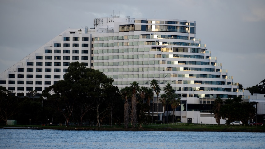 A wide shot of Crown Casino Perth with the Swan River in the foreground.