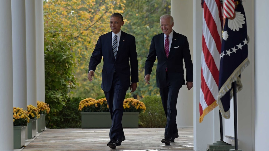 President Barack Obama and Vice President Joe Biden walk from the Oval Office to the Rose Garden at the White House in Washington, Wednesday, Nov 9, 2016.
