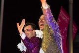 Two men wave during the Sydney Mardis Gras.