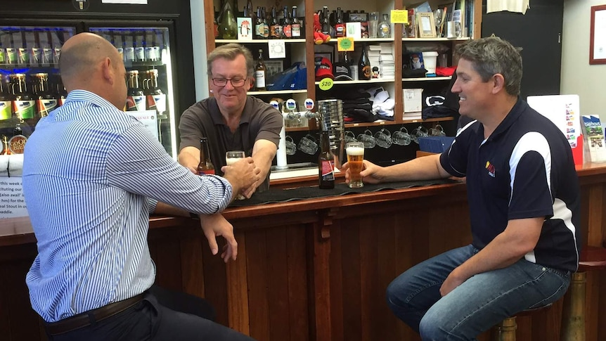 Ben Wigzell and Hayden Battle sit at a bar tasting lentil beer for the first time at Lobethal Bierhaus.