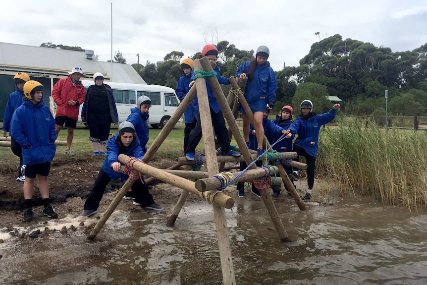 Students working in a bridge building exercise.
