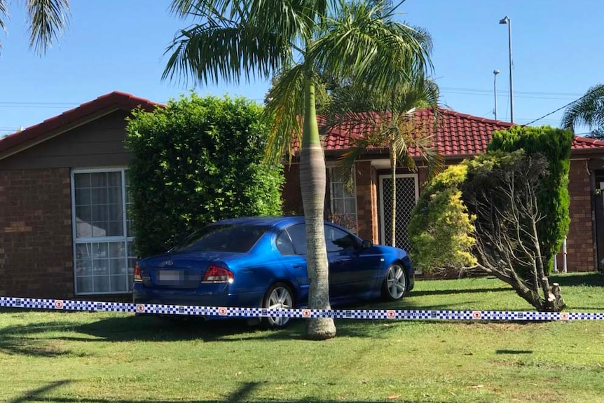 Police tape around a house at Browns Plains south of Brisbane where two men who allegedly shot a 10-year-old boy and his father.