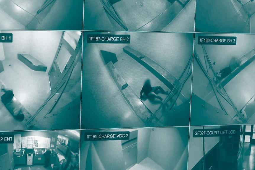 A monitor displaying CCTV of inmates at Brisbane watch house