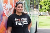Lani Pomare posing with the Regional Youth Support Services bus