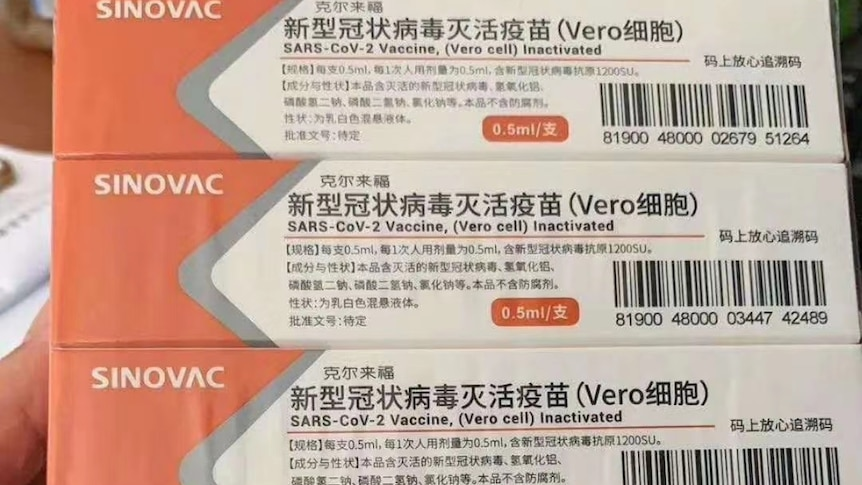 Some boxes of Chinese COVID-19 vaccines on a desk.