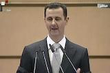 Bashar al-Assad delivers a speech