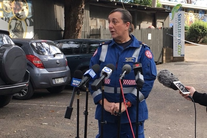 A female ambulance officer speaks to the media.