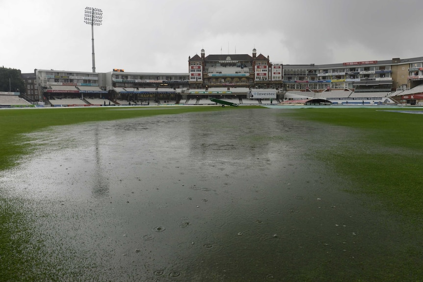 Puddles form on the field at The Oval as play is abandoned for the day during day four of the fifth Ashes Test.