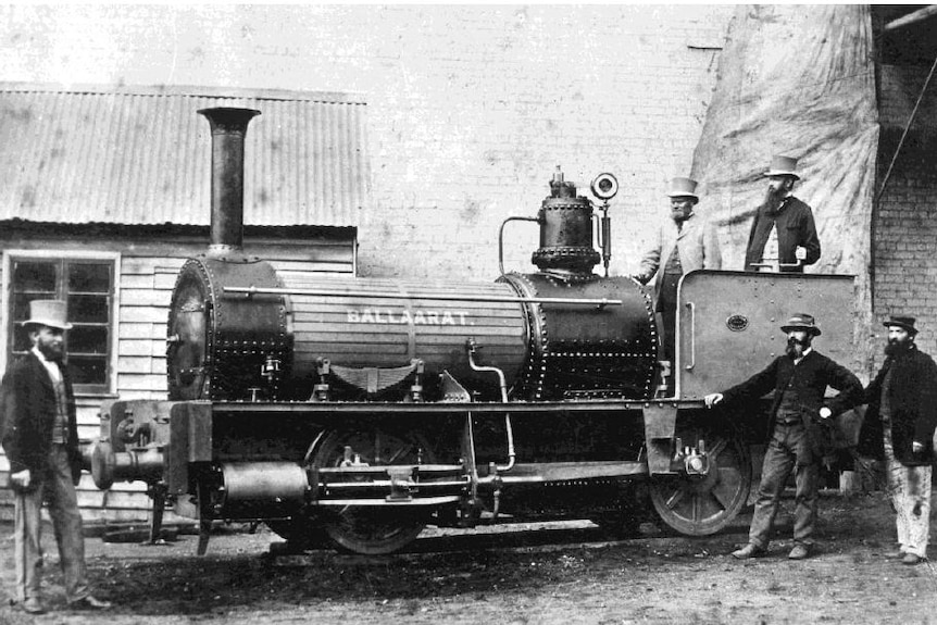 The Ballaarat Locomotive, surrounded by men, in a Ballarat train yard in 1871.