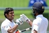 Kusal Mendis celebrates his first Test century with Dinesh Chandimal