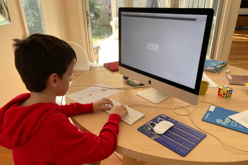 Student sitting at computer at home unable to log in.