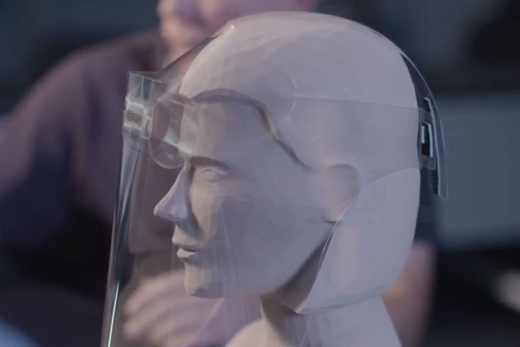 A dummy's head wearing a plastic shield to protect against coronavirus.