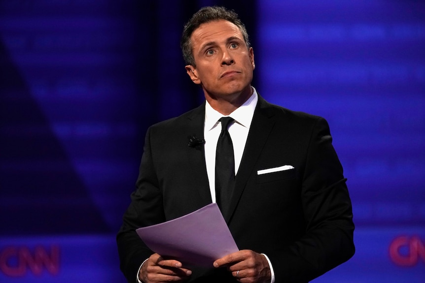 Chris Cuomo at a televised debate with politicians