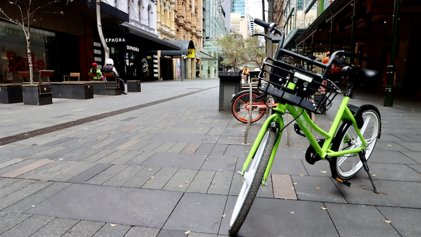 Share bicycles sit amid an empty Pitt Street mall during Sydney's lockdown.