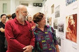Punters at exhibition of old photographs