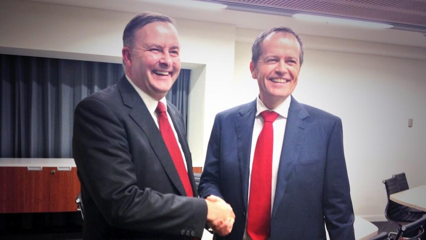 Anthony Albanese and Bill Shorten shake hands before the Labor leadership debate