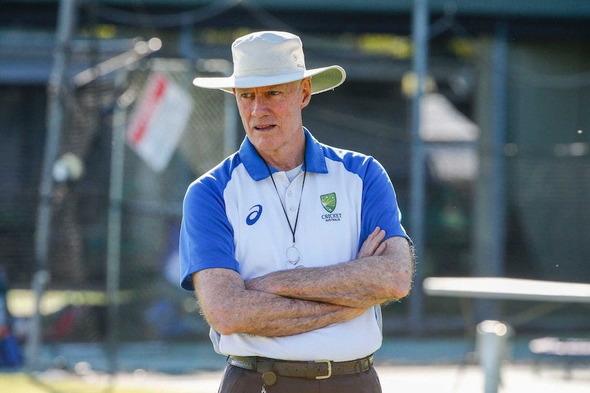 Greg Chappell stands with his arms crossed during training.