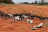 Empty bottles of alcohol discarded on the road into Papunya