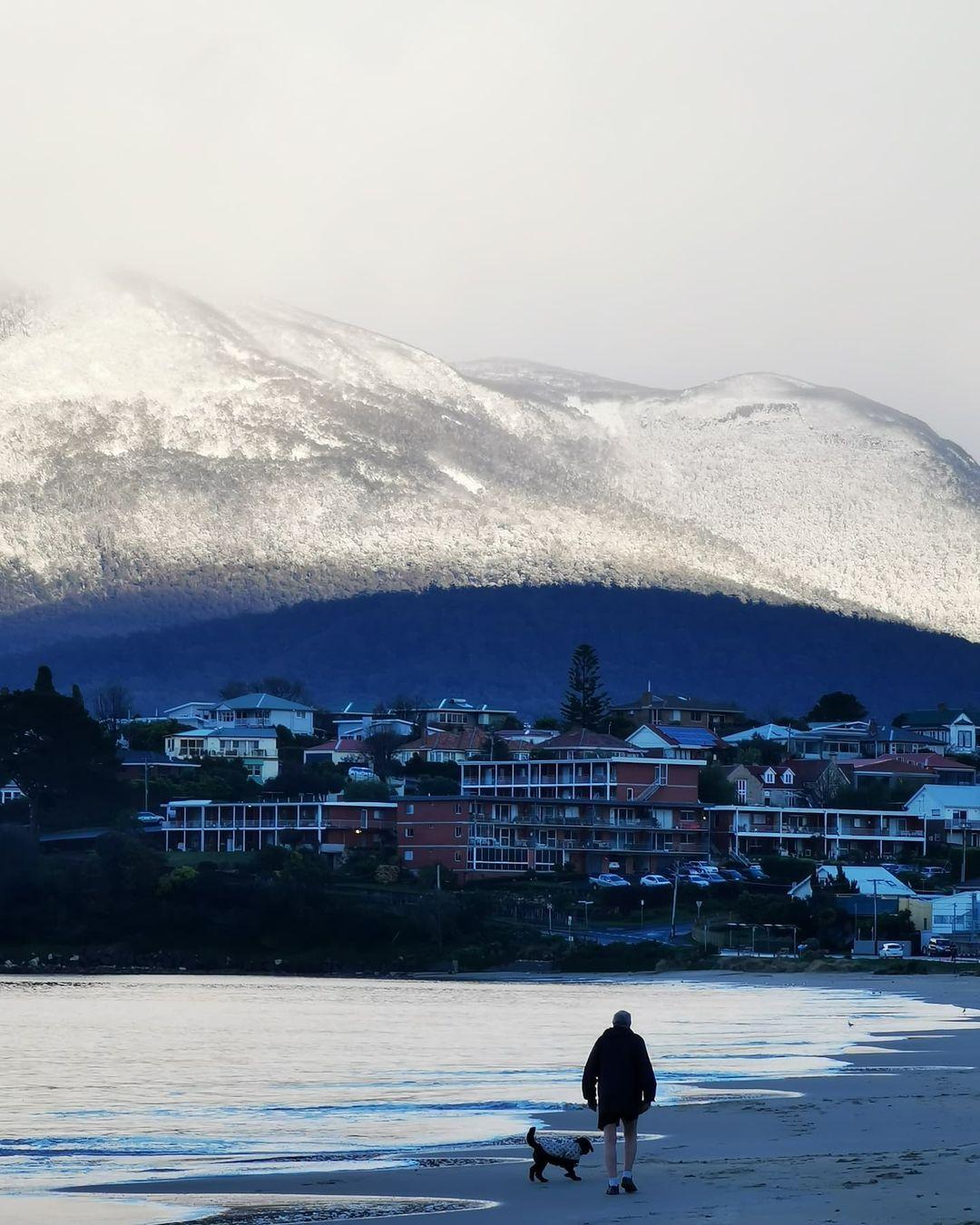 Snow on kunanyi/Mt Wellington seen from Bellerive beach, Tasmania. August 2021