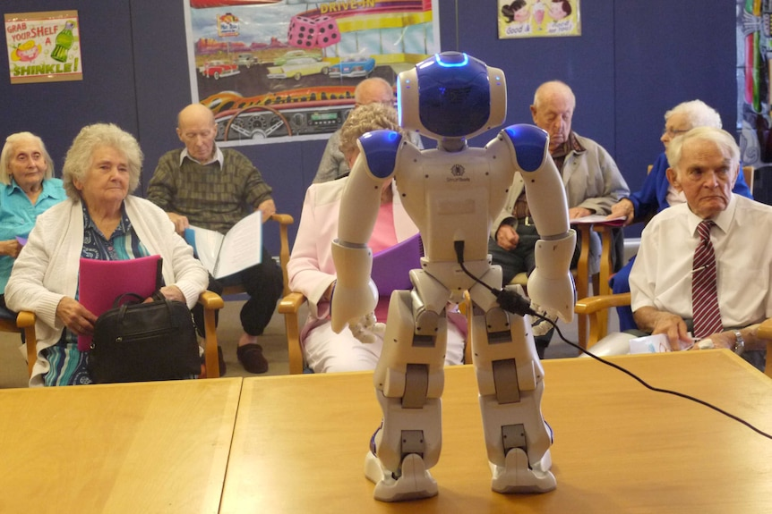 Alice the robot charges up for the Madeley singing group