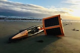 yacht looking research sail drone washed up on beach