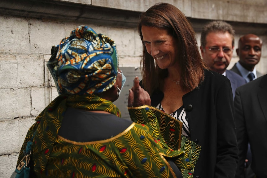 Belgium's Prime Minister Sophie Wilmes speaks with the public after unveiling a plaque marking Congolese independence.