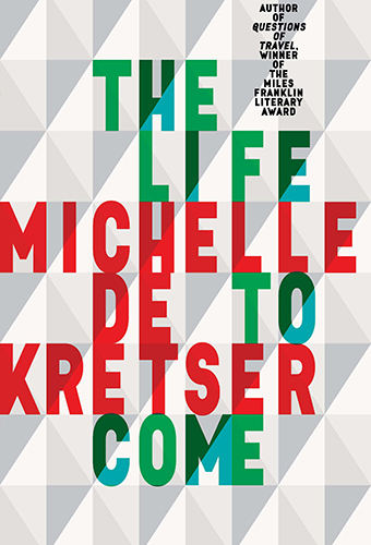 The cover is a geometric pattern, interlocking triangles, of grey, white, green and red