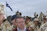 Defence Minister Joel Fitzgibbon surrounded by Australian troops in Iraq