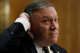 Mike Pompeo scratches his head