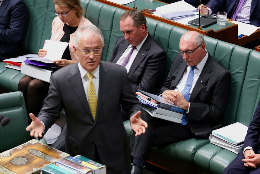 Warren Truss appears to be asleep while Malcolm Turnbull speaks in Parliament.