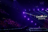 The Eurovision logo can be seen on stage, as fans pack the stands to watch the first semi-final in Rotterdam.
