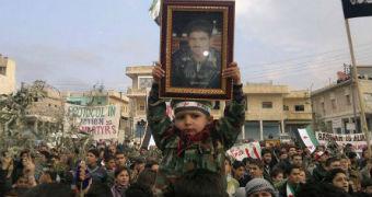 Demonstrators protest against Syrian president Bashar al-Assad in 2011.