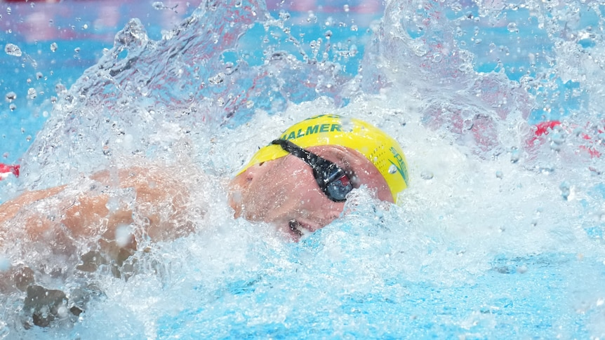 An Australian male swimmer competing in a 100 metres freestyle heat at the Tokyo Olympics.