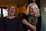 Greens Senator Janet Rice and her partner Penny Whetton laugh at the camera.