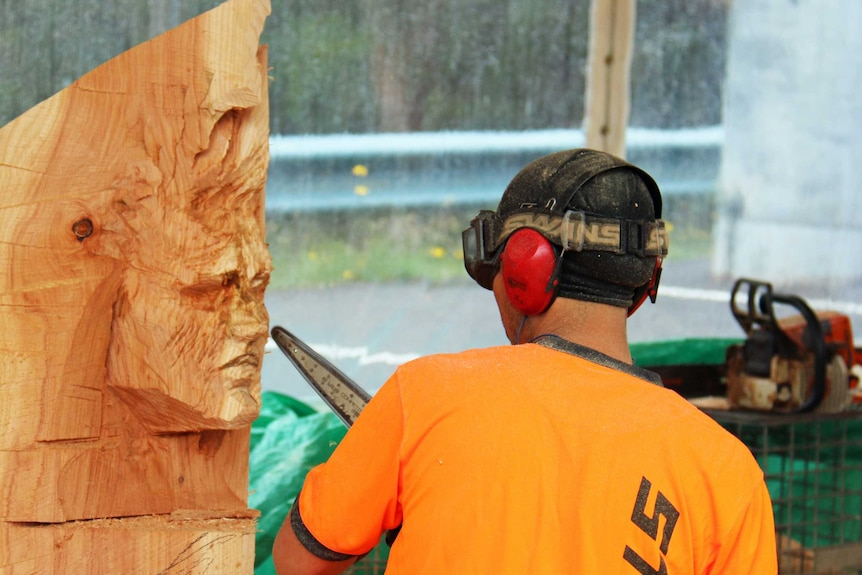 Contestant carves a sculpture at the Australian Chainsaw Carving Championships.